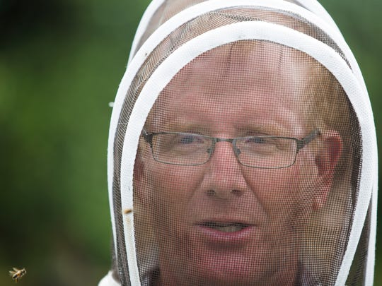 Tom May talks about beekeeping in Florida compared with other places in the United States on Tuesday, June 20, 2017, at the South Naples Citrus Grove. May has hives across Southwest Florida.