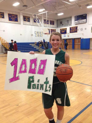 Spackenkill's Anna Thompson scored her 1,000th career point on Friday at Ellenville.