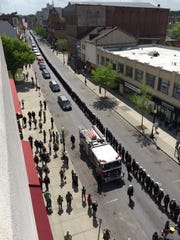 Timothy Gunther's funeral procession moves down Main