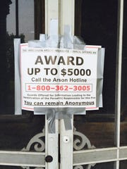 A photo of the reward posting on the remains of the