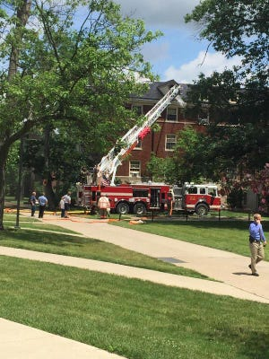 Crews respond to a fire in the attic of Swing Hall at Miami University.