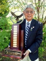 Service-minded Pensacola City Councilman P.C. Wu holds