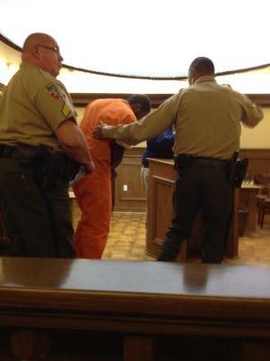 Brandon Bowling, 22, is removed from the courtroom after his case was bound over to the grand jury Aug. 26.
