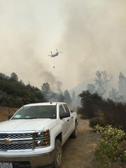 Tennessee Department of Agriculture Forestry Division firefighters combat a fire out West.