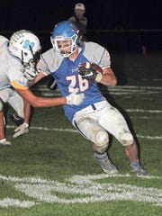 BGM's Colton Massengale, 28, fights for yardage against Lynnville-Sully. Massengale gained 190 yards on 33 carries for the Bears in the 44-0 win.