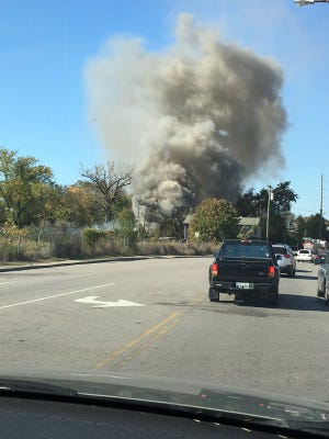 Plumes of smoke rise from the area of an apparent explosion on Craighead Street.