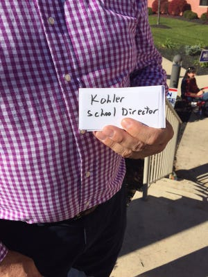 Lynn Kohler, candidate for West York Area school board,  with one of the no frills handbills he was handing out to voters Tuesday at Shiloh Fire Company in West Manchester Township.