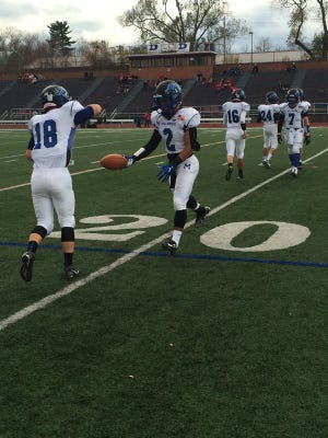 Delvin Wood and the rest of the Millbrook football team getting loose before the Section 9 Class C title game.