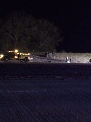 A tow truck prepares to move a vehicle involved in a rollover on Interstate 29.