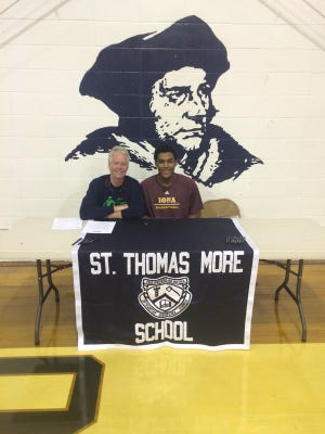 Former Spring Valley star Kai Mitchell signs with Iona College during a ceremony at St. Thomas More in Oakdale, Conn. on Nov. 12, 2015.
