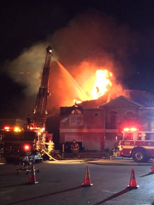Fire fighters fighting a possible vacation home on Pensacola Beach Thursday night.