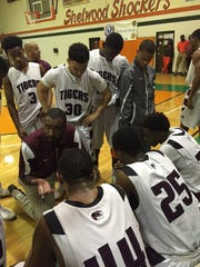 PHS coach Terrence Harris talks to his team during