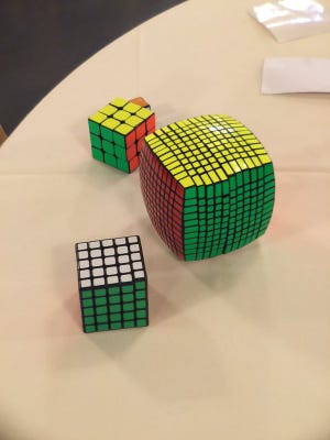 The chattering and clicking sounds of handheld puzzles being solved filled a ballroom at the Highlander Event Center at 90 Alexandria Pike in Fort Thomas, Kentucky for the 2016 Queen City Rubik's Cube Tournament. About 200 attended the event, and 85 puzzler solvers of varying ages competed.