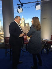 Mike Huckabee talks with CNN's Erin Burnett Monday morning. The former Arkansas governor ended his presidential campaign later that day after failing to place in the top three in the Iowa caucuses.