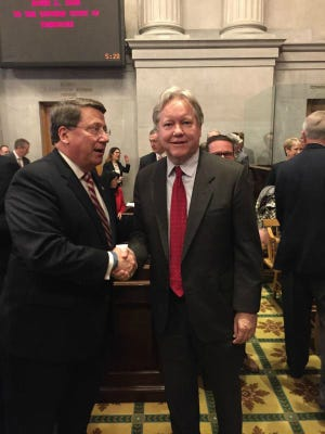 Senate Majority Leader Mark Norris, left, congratulates Roger Page, who was named to the Supreme Court, after lawmakers met in a historic joint convention on Monday.
