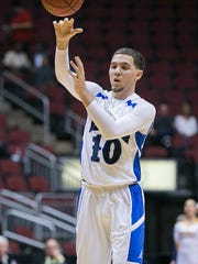 Shadow Mountain's Michael Bibby makes a pass in the