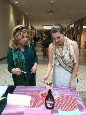 Cumberland County 4-H Agent Julie Karavan (left) and 4-H Ambassador Jillian Tozer review an entry at the 2016 Cumberland County 4-H Favorite Foods Show at Cumberland Mall in Vineland.