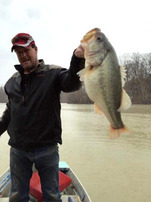 Tommy Myers of Hopkinsville, Ky., shows off a 12-pound, 4.5-ounce bass he caught on Lake Morris.