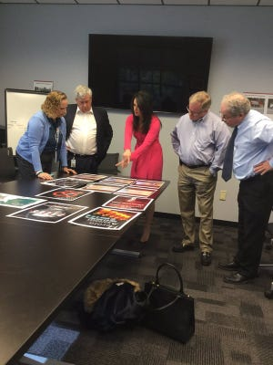Members of the York County community judge designs for billboards students made about heroin. From left are Coroner Pam Gay, District Attorney Tom Kearney, Mel Orlins, Senator Scott Wagner and Tom Loper of Lamar Advertising.
