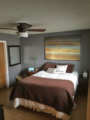 Couple's bedroom goes from dated to dramatic