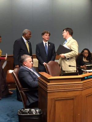 From left, Rep. Joseph Bouie, D- New Orleans, speaks with the House Civil Law Committee chairman Ray Garofalo, R-Chalmette, and Rep. Mike Johnson, R-Shreveport, before Monday's meeting,.Rep. Clay Schexnayder, R-Gonzales, is seated in the foreground.