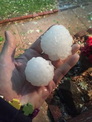 Susan Goodwyn holds hail in her hand Tuesday, April