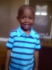 Xavier Strickland,4, was mauled by four pit bulls as his mother tried to save him.