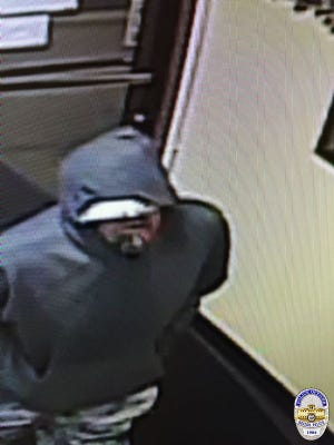 Surveillance footage of the suspect in two armed robberies that occurred in Keizer on Sunday, June 26.