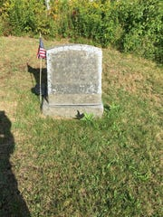 The Lester Bryant stone in Lee Cemetery, Lincoln, before it was cleaned.