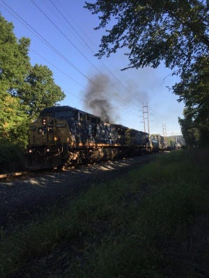 Smoke rises from a CSX train that stopped in Congers after a fire broke out in one locomotive