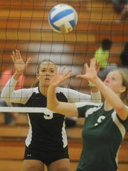 Stefanie Jankiewicz anticipates a spike attempt from the opposing team.