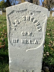 William John Sheehy's grave marker, seen when it still had a pointed top.
