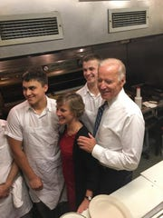Sue Minter, left, and Vice President Joe Biden, visit the cooks in the kitchen at Penny Cluse Cafe Friday morning.