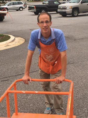 Photo caption: Sean Canning returning to the store after loading up a customer's car with their Home Depot purchases.