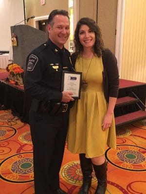 West Lafayette police Chief Jason Dombkowski (left) on Wednesday was named 2016 Outstanding Law Enforcement Officer by the Indiana Coalition Against Domestic Violence. Jasmine Moisides (right), director of the YWCA of Greater Lafayette's domestic violence intervention and prevention program, nominated Dombkowski for the recognition.