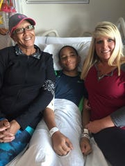 Isaiah Griffin is flanked by his mother, Deborah Griffin, and school nurse Carrie Stephenson this weekend at Le Bonheur Children's Hospital in Memphis.