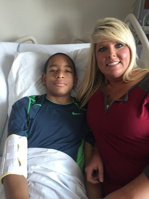 Carrie Stephenson, a nurse who works at West Bemis Middle School, helped take care of Isaiah Griffin when he became ill  Friday at school. Isaiah's mother credits Stephenson for Isaiah being alive.