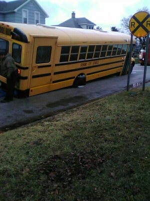 While at a stop, a Fremont City Schools bus sank into a sinkhole on Cherry Street on Tuesday morning. The sinkhole developed because of a water main break.