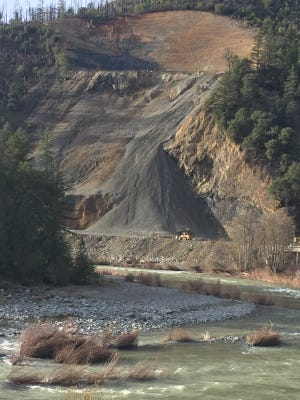 Work continues on clearing a landslide and repairing the road on Highway 299 about 30 miles west of Weaverville.