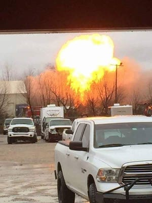 The fireball of an explosion is visible from near NRG Transportation on Scott Avenue Tuesday afternoon.