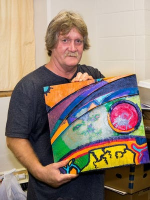 Jimmy Naramore with his art at Highland Heights United Methodist Church in 2015.