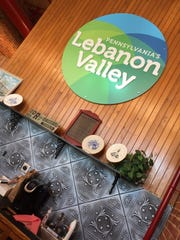 A sign promoting the Lebanon Valley hangs on the wall of Visit Lebanon Valley's office in the Lebanon Farmers Market.
