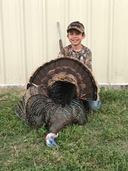 Eduardo Barrera, 9, killed his first turkey while hunting with hid dad on a South Texas ranch.