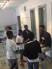 Tyus Battle chats with students at Write on Sports at Roselle Catholic High School.