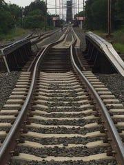 This rail bridge in Pennsauken was damaged when a garbage truck struck it Friday.