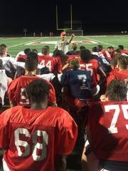 Dixie State head coach Shay McClure talks to his team