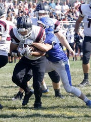 Jarrid Lewis runs for a touchdown for Elmira as Billy