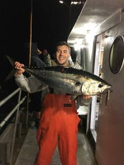 Erik Bogan with a tuna landed on the 125-foot Jamaica party boat.