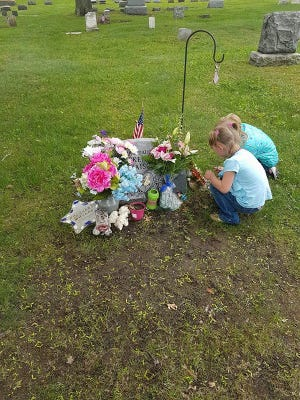 Mackenzie Maison's sister visit her grave.The convictions of her father and step-mother in her death were recently affirmed by the Michigan Court of Appeals.