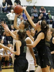 Elmira's Kiara Fisher drives for a layup against Vestal